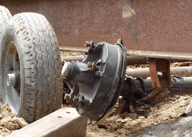 A close-up of one of the front piece carrier's axle that bent from the strain placed upon it while being backed up the street to the construction site.